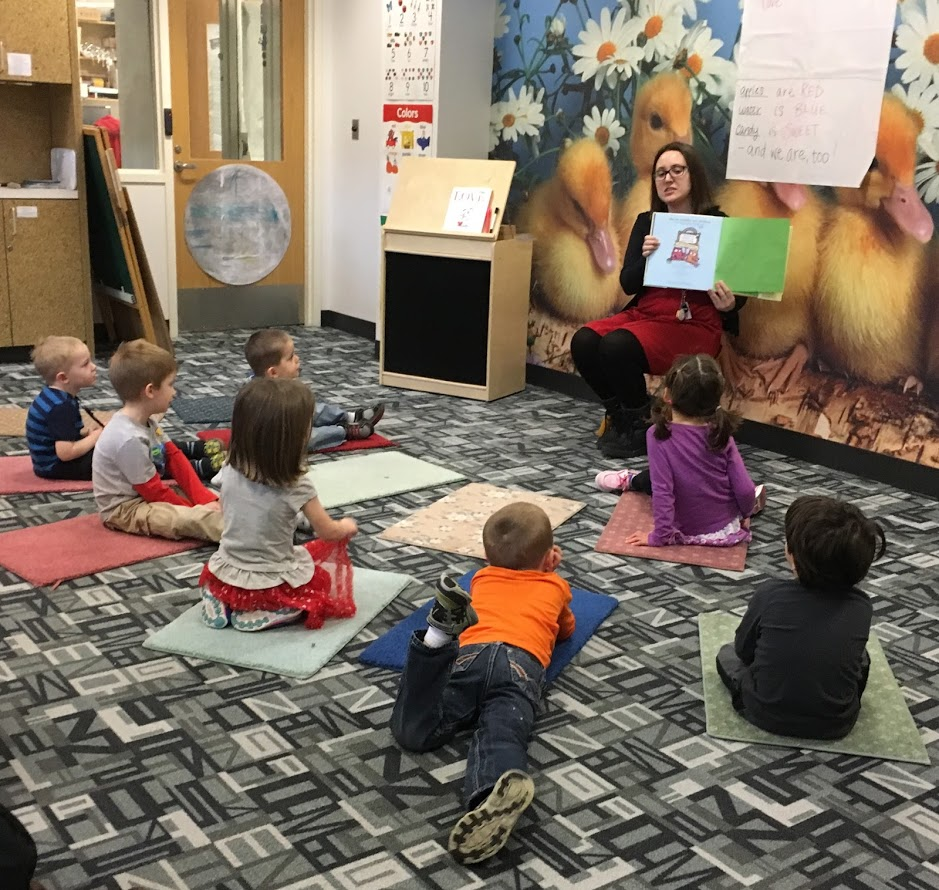 Librarian reading to a story time class